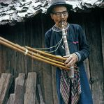 Mao hill tribe man with musical instrument.