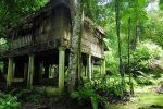 Old derelict building adjacent to Kwang Si waterfall near Luang Prabang.