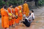 Monks from Wat don Muang receiving alms.