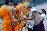 Monks receiving morning alms