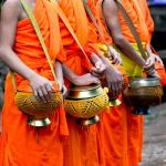 Monks with their food bowls.